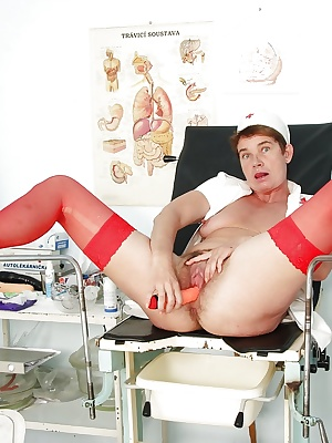 Salacious mature nurse in red stockings playing with her toys
