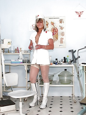 Lecherous mature nurse revealing and toying her shaved twat