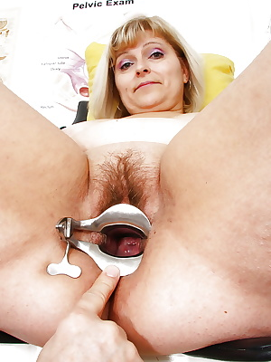 Obese older blonde having hairy snatch penetrated by gyno doc with speculum