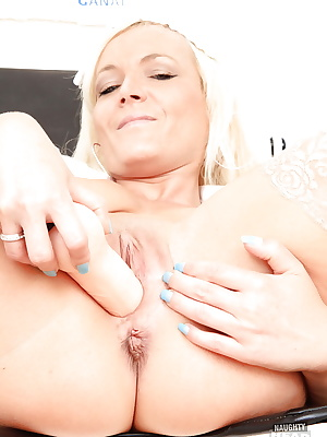 Chubby mature nurse taking off her panties and stuffing her shaved cunt