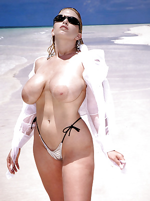 Sunglasses topped mature woman Dawn Stone flaunting big wet tits on beach