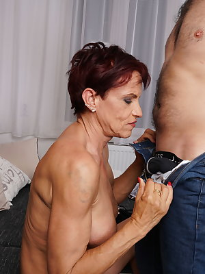 Heavily pierced German mature lady seducing her toy boy