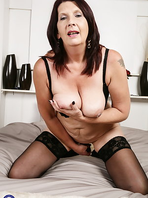 Naughty British older lady playing with her pussy