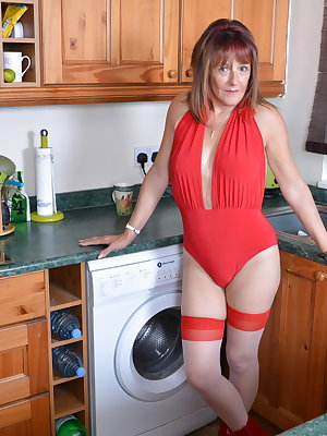 This British housewife gets wet in her kitchen
