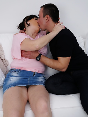 Curvy housewife playing with her toy boy
