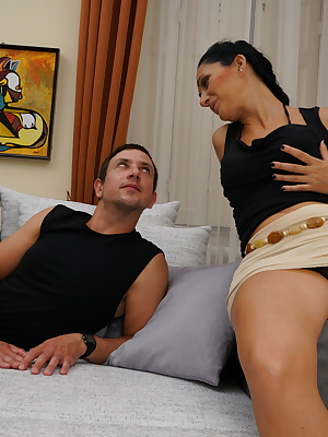 Horny housewife fucking on her couch