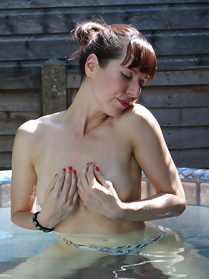 Naughty British housewife playing at the hottub