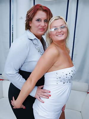 Two lesbian housewives get ready for playtime