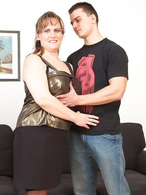 Big breasted mature slut playing with her toy boy