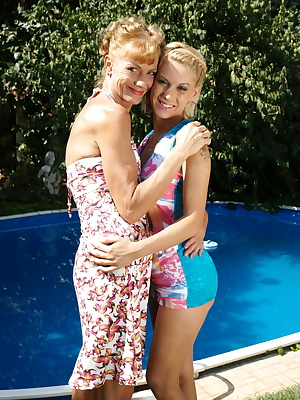 Two old and young lesbians making out at the pool