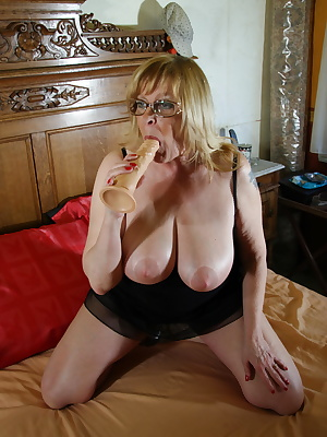 Big breasted mature mama getting wet and wild
