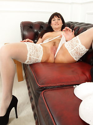 Steamy hot British housewife playing with her huge dildo