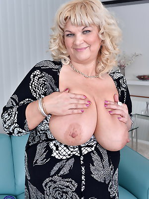 This big breasted mature mama loves to get wet