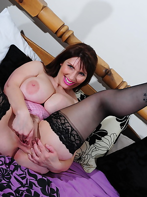 Huge breasted mature slut showing all