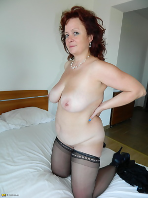 Big breasted matue slut showing her good stuff