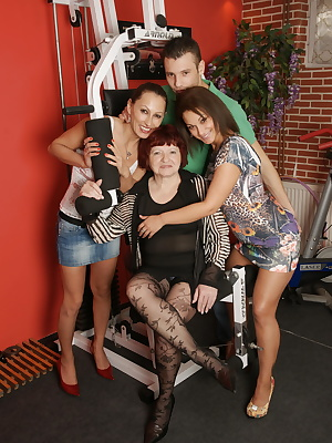 Two older ladies having fun with a young couple