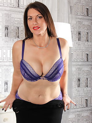 Big breasted British MILF playing all by herself