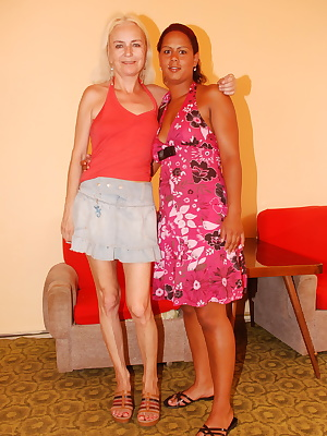 Interracial old and young lesbians at play