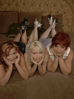 Two mature lesbians have sex with a young hot babe