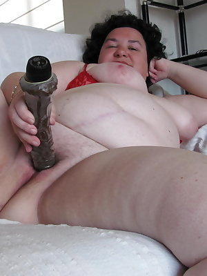 Big mature mama playing with a rubber dildo