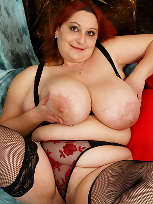 Huge breasted mama playing with herself
