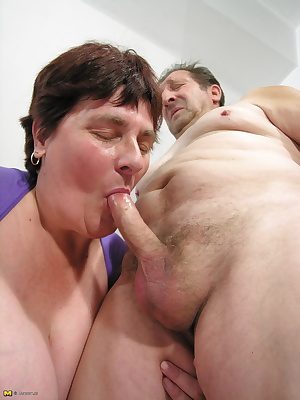 Big mama enjoying two old cocks