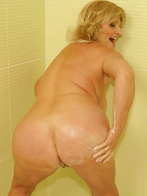 Horny mama playing with herself in the shower