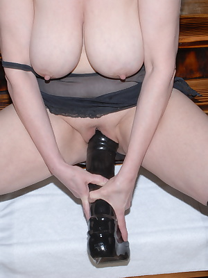 Red mature slut playing with her huge toys