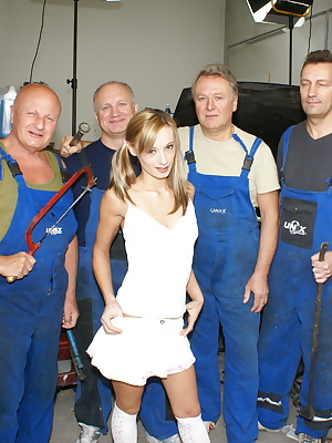 hot teen takes on a garage full of horny old men