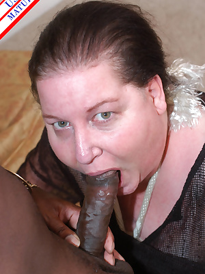 Chubby mature slut munching on a black cock